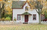 House with falling leaves