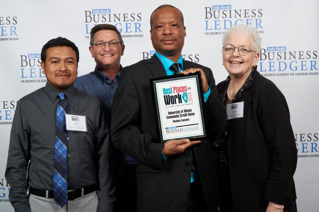 UICCU Staff Holding Best Places to Work Award