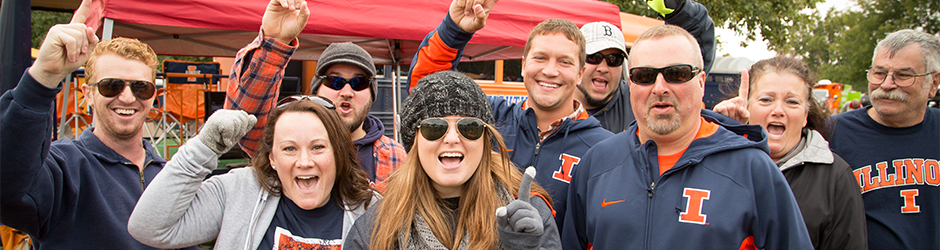 People Cheering During a Tailgate